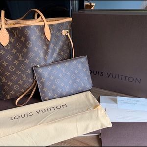 Louis Vuitton MM Neverfull tote.